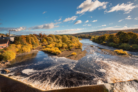 weir: River Tyne below Hexham Bridge, and Weir, on a sunny day in autumn Stock Photo