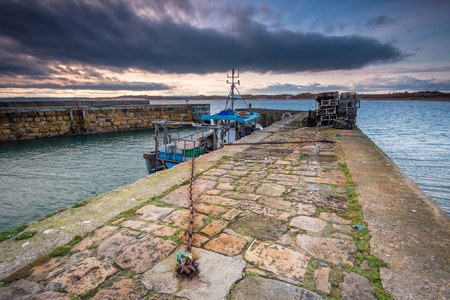 Beadnell Harbour North Pier, at Beadnell village on the Northumberland coastline, with a small fishing harbour set into Beadnell Bay.  Disused medieval Lime Kilns sit in the harbour