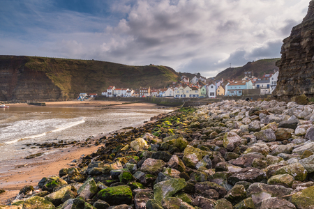 Rocks in Staithes Harbour - Staithes is a pretty seaside village and fishing port on the North Yorkshire coastline, and is today an attractive tourist destination