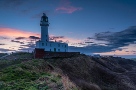 Twilight at Flamborough Head Lighthouse - Flamborough Head is an eight mile long promontory on the Yorkshire coastline. It is a chalk headland, with sheer white cliffs Stock Photo