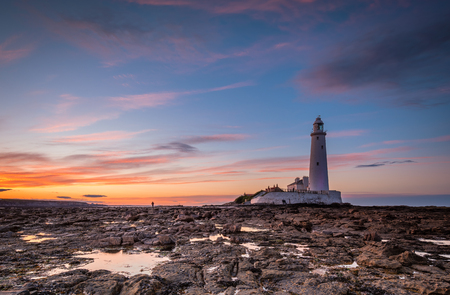 Dusk at St Marys Lighthouse - St Marys Lighthouse on the small rocky St Marys Island, just north of Whitley Bay on the North East coast of England. A concrete causeway submerged at high tide links it to the mainland