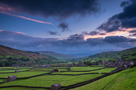 Gunnerside at Dusk - Swaledale in Yorkshire Dales National Park winds into the northern Pennines. It is famous for its meadows, field barns and drystone walls. Stock Photo