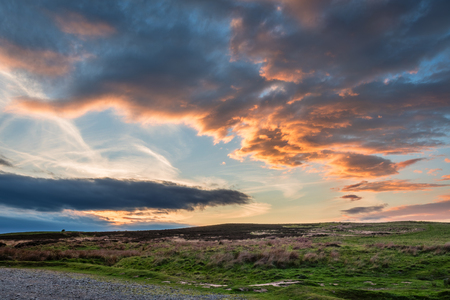 Sunset over Lordenshaws Hillfort, located at the foot of the Simonside hills near Rothbury, in the Northumberland National Park, which is popular with walkers