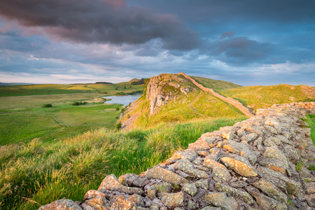 Hadrians Wall above Highshield Crag, which is a World Heritage Site in the beautiful Northumberland National Park. Popular with walkers along the Hadrians Wall Path and Pennine Way Stock Photo