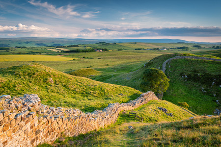 Hadrians Wall above Steel Rigg, which is a World Heritage Site in the beautiful Northumberland National Park. Popular with walkers along the Hadrians Wall Path and Pennine Way Фото со стока