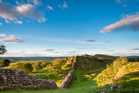 Roman Wall in late evening sun, also known as Hadrians Wall, is a World Heritage Site in the beautiful Northumberland National Park. Popular with walkers along the Hadrians Wall Path and Pennine Way Stock Photo