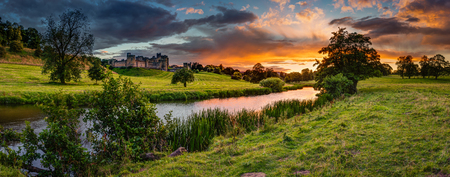 Panoramic Sunset over River Aln, which runs through Northumberland from Alnham to Alnmouth. Seen here in panorama below Alnwick Town and Castle on the skyline, as the sunsets