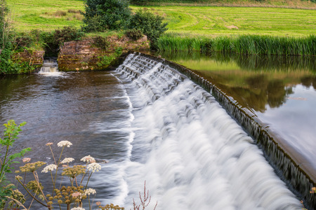 River Aln Weir and Fish Pass, the river running through Northumberland from Alnham to Alnmouth. Here below Alnwick is one of the weirs along its length