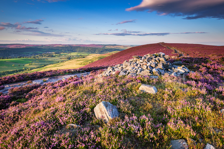 Cairn on Simonside Hills Ridge, which is popular with walkers and hikers, the Simonside Hills are covered with heather in late summer and are part of Northumberland National Park overlooking Coquetdale and Cheviot Hills