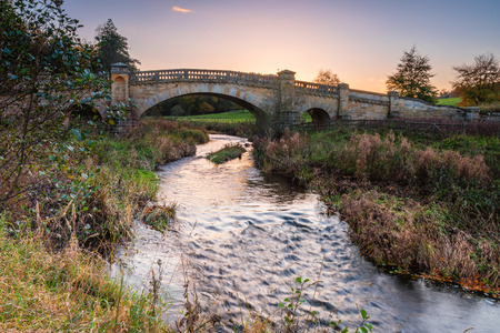 River Wansbeck under Wallington Bridge, the river rising in the Northumberland hills above Sweethope Lough, then journeys towards the North Sea near Newbiggin Stock Photo