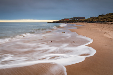 Cresswell Village from the beach, at Druridge Bay which is a seven mile long beach in Northumberland between Amble to the north and Cresswell to the south