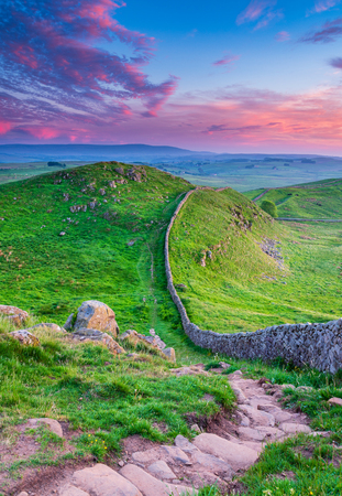 Golden Light at Hadrians Wall Caw Gap in the beautiful Northumberland National Park. Popular with walkers along the Hadrians Wall Path and Pennine Way