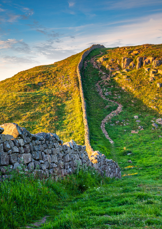 Hadrians Wall portrait at Caw Gap in the beautiful Northumberland National Park. Popular with walkers along the Hadrians Wall Path and Pennine Way