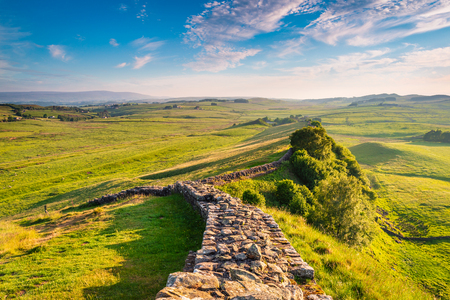 Golden Light at Hadrian's Wall Caw Gap in the beautiful Northumberland National Park. Popular with walkers along the Hadrian's Wall Path and Pennine Way Stock Photo