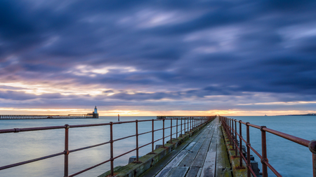 Mouth of the River Blyth in Blue Hour, as he river reaches the North Sea between the piers of Blyth Harbour in Northumberland