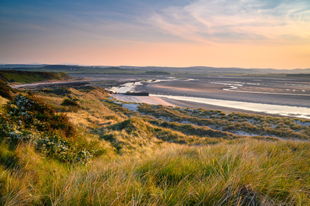 Mud Flats and Dunes at Budle Bay, seen here at low tide they are part of Lindisfarne Nature reserve on Northumberland's AONB coastline