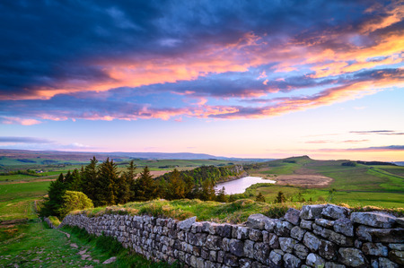 Crag Lough and Hadrian's Wall at Sunset, a  popular with walkers along the Hadrian's Wall Path and Pennine Way