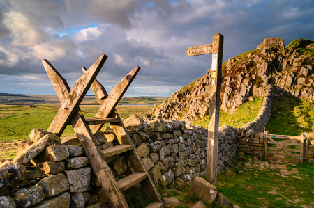 Pennine Way Style and Sign Post at Hadrian's Wall, a popular with walkers along the Hadrian's Wall Path and Pennine Way