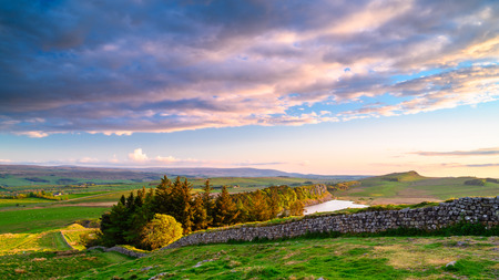 Hadrian's Wall and Crag Lough, a popular with walkers along the Hadrian's Wall Path and Pennine Way Stock Photo