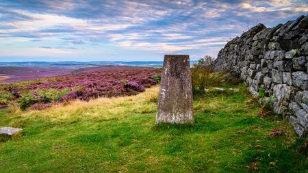 Trig Point on Ros Hill, also known as Ros Castle due to an ancient prehistoric Hillfort on its summit, located near Chillingham in Northumberland and has great views all around it