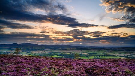 Sunset over the Cheviot Hills from Ros Hill, also known as Ros Castle due to an ancient prehistoric Hillfort on its summit, located near Chillingham in Northumberland and has great views all around it
