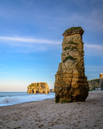 Weathered Sea Stacks at Marsden Bay, located near South Shields, consisting of a sandy beach enclosed by Magnesian Limestone Cliffs and sea stacks Stock fotó