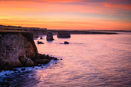 Twilight at Marsden Bay, located near South Shields, consisting of a sandy beach enclosed by Magnesian Limestone Cliffs and sea stacks Stock fotó