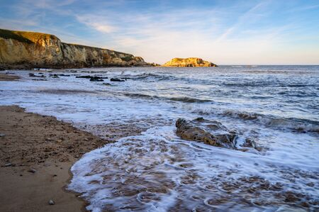 Retreating Wave at Marsden Bay, located near South Shields, consisting of a sandy beach enclosed by Magnesian Limestone Cliffs and sea stacks