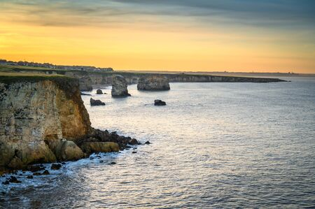 Marsden Bay at Sunset, located near South Shields, consisting of a sandy beach enclosed by Magnesian Limestone Cliffs and sea stacks