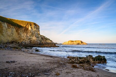 Marsdens Bay northern cliffs, located near South Shields, consisting of a sandy beach enclosed by Magnesian Limestone Cliffs and sea stacks