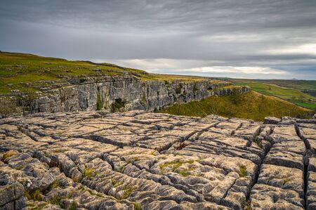 Limestone Pavement above Malham Cove, in Malhamdale which is extensive at the top where the Pennine Way passes by 写真素材