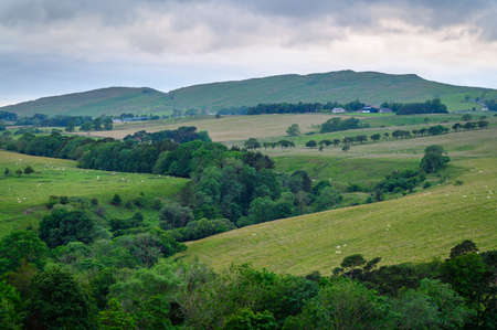 Winshield Crags viewed from Vindolanda, as Hadrians Wall sits upon the top of the crags above the Roman Fort of Vindolanda in Northumberland. The Sill just visible on the left.