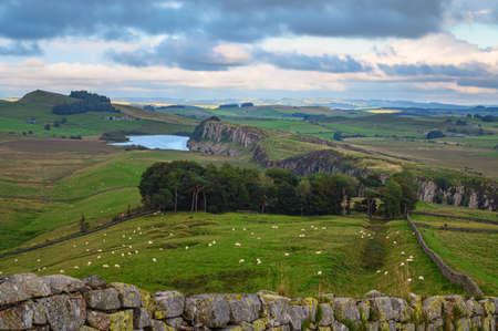 Hadrians Wall approaching Steel Rigg, a UNESCO World Heritage Site in the beautiful Northumberland National Park, popular with walkers along the Hadrian's Wall Path and Pennine Way