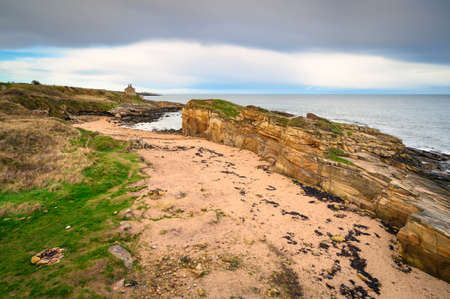 Rumbling Kern Beach from the Clifftop, on the rocky shoreline at Howick on the Northumberland coast, AONB, where there are several sandy coves