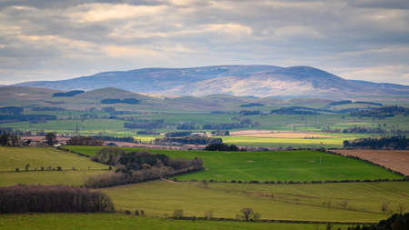 The Cheviot and Hedgehope Hill, in the Cheviot Hills, a range of rolling hills straddling the Anglo-Scottish border viewed here from Corby's Crags in early springtime