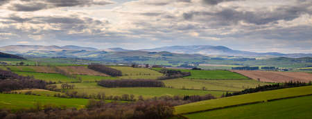 Panorama of the Cheviot Hills, a range of rolling hills straddling the Anglo-Scottish border viewed here from Corby's Crags in early springtime
