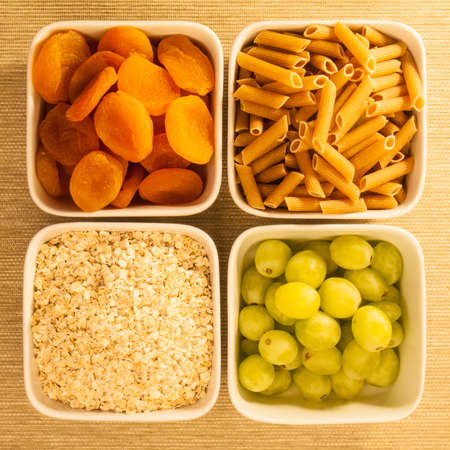 as selection of low glycemic index food in square bowls viewed from above photo