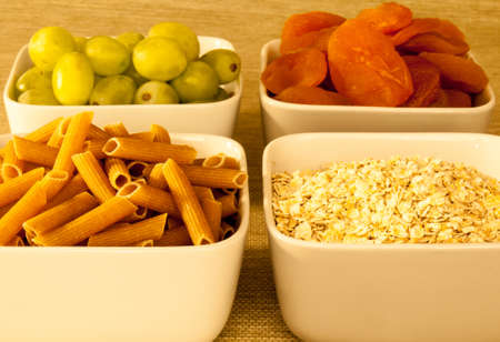 glycemic: as selection of low glycemic index food in square bowls viewed from the side