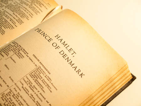 an old copy of the complete works of shakespeare open at the first page of Hamlet  Focus on the title   yellow ageing of page edges clearly visible Stock Photo - 20901896