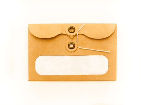 adress: brown paper string and button envelope against white background with blank adress window Stock Photo