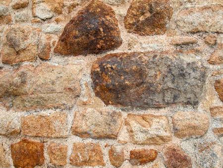 masonary: aged and weathered old rsandstone wall