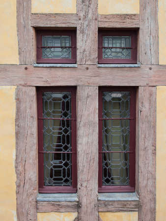 detail of a  window in a historical half timber  building photo