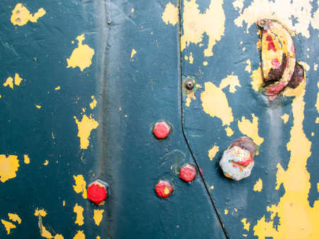 flaking: background of aged flaking paint on rusty iron with bolts