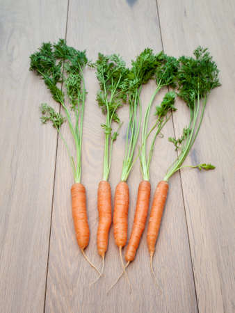 glycemic: Arangment of Fresh carrots on aged wooden background