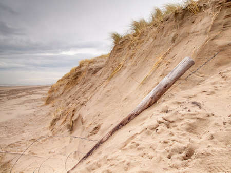 landslip: Errosion in the dunes. A landslip caused by heavy storms on the north sea coast