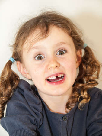 bright eyed: portrait of little bright eyed girl with long curly hair who