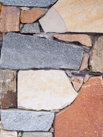 masonary: architechtural detail of grey, red and bown stone built wall Stock Photo