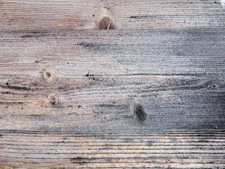 architectural detail of aged and weathered wooden planks running horizontally photo