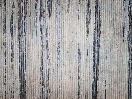 ridged: detail of roughly ridged aging grey stone masonry with dark weathered streeks