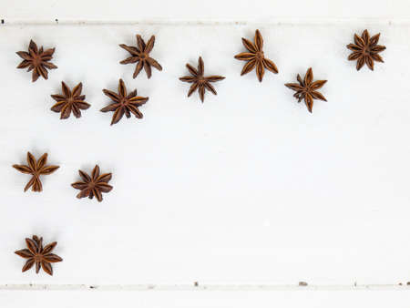 arrangment: an arrangment of star anise on a rustic white table top with copy space Stock Photo